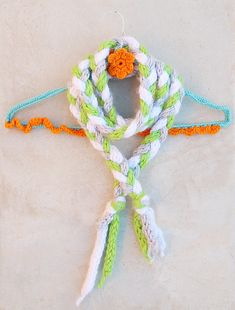 A finger knit braided scarf is a perfect winter craft for kids of all ages, and something they can proudly wear!