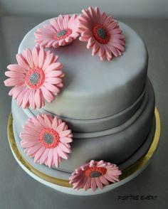 Grey wedding cake with gerberas