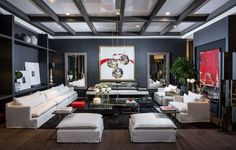 Mirtha Arriaran // Valentino - Touches of red and lace accents line Mirtha's living space of black, white and cool grays. With contemporary art additions and sleekly shaped furniture, the room epitomizes Valentino's bold vibe. - HarpersBAZAAR.com