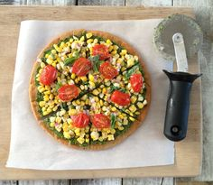 Quinoa pizza crust. The pizza crust has garlic in it, but the crust can be made without seasonings to be used as a base for a fruit pizza.