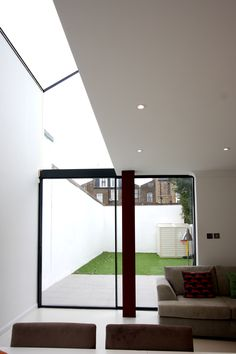 minimal windows as patio sliding doors to side infill extension