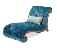 This peacock velvet armless chaise would be perfect seating for a library