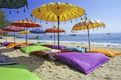 Explore the endless sandy beaches of Southern Bali and the luxury hotels in the town of Seminyak on an Original Travel holiday to Indonesia. Denpasar, Kuta, November Holiday Destinations, Balinese Decor, Colorful Umbrellas, Colourful Cushions, Surfer, Going On Holiday, Holiday Ideas