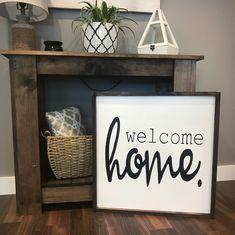 Large framed sign. Welcome home. Entry sign