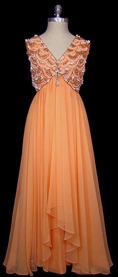 Beaded and embroidered orange chiffon evening dress, circa 1962.