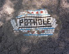 "An artist in Chicago is creating ""pothole street art"" with mosaic tiles."