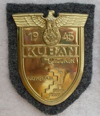 The Kuban Shield, was a World War II German military decoration awarded to those who fought to preserve the bridgeheads in the Kuban region from February 1943 until they were abandoned in October.The shield is designed in a similar fashion to the Crimea Shield and was struck in sheet metal or zinc and treated with a bronzed wash. It features a German eagle with outstretched wings clutching a laurel wreath with the swastika inside this.