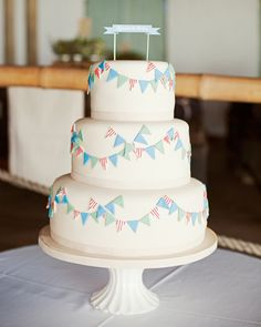 Festive wedding cake with blue bunting detail by nellecakes.co.za welovepictures.bl...