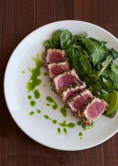 sesame crusted seared ahi tuna with arugula