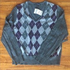 NWT beautiful merino wool argyle sweater xl This is a timeless sweater! Beautiful soft merino wool w argyle front. Sz xl and is NWT. Nonsmoking home. Sweaters V-Necks