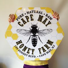 A wooden sign with vinyl print for Cape May Honey Farm.