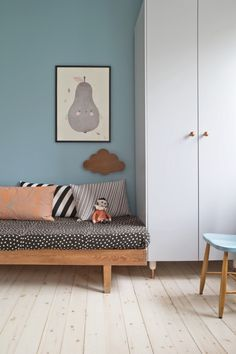 Tiny room | We can just see the armoire and the wood bed but we can feel that it is a cozy bedroom, the wall art and the little toy helps to get this warm feeling | See more: http://kidsbedroomideas.eu/ #kidsroom #kidsbedroomideas