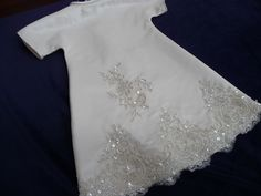 Angel gown with beaded lace appliqued panels.