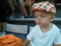 Awesome orange hat - this kid has got style!