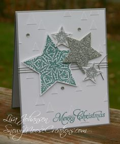 Stamps: Bright and Beautiful, More Merry Messages  Paper: Smoky Slate, Whisper White, Silver Glimmer Paper  Ink: Lost Lagoon, Smoky Slate  Accessories: Big Shot, On Point TIEF, Stars Framelits, Basic Rhinestone, Silver Stretch Cord, dimensionals