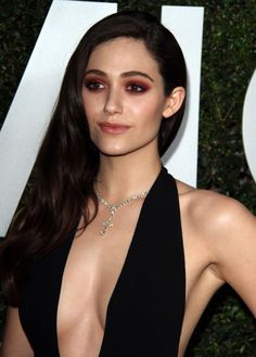 Emmy Rossum in black low cut Michael Kors: gorgeous or bad makeup?