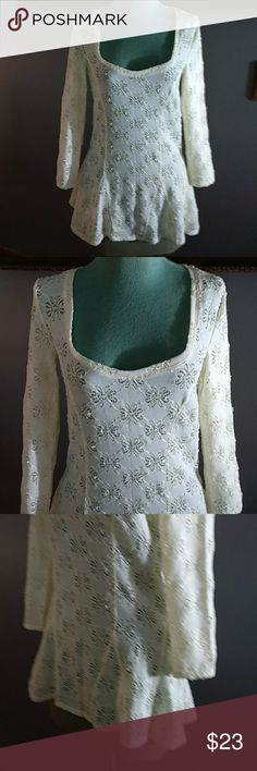 "Free People Shirt Ivory colored nylon and spandex blend with a floral eyelet design on it has a scoop neck line in front and a semi flared bottom part has 3/4 sleeves is 29"" long great for layering over things Free People Tops"