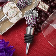 Sparkling Grapes Wine Themed Wedding Favor Stoppers (FashionCraft 1938) | Buy at Wedding Favors Unlimited (http://www.weddingfavorsunlimited.com/sparkling_grapes_bottle_stopper_in_vineyard_themed.html).