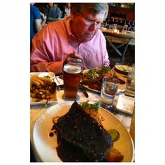 The father-in-law with a plate full of meat at the a butcher and the boar. With @sweetwaterstyle @lawyerinheels