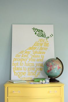 I love everything about this. the yellow dresser, the verse, the globe....would be good for any room, esp baby or kiddo.