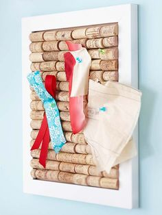 Upcycle wine corks into a stylish DIY bulletin board. Find out how it was made here: http://www.bhg.com/christmas/gifts/cute-and-practical-handmade-christmas-gifts/?socsrc=bhgpin122112winecorkboard=3