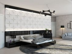 This bedroom setup boasts a huge headboard feature wall, where concave tiles play with light and shade. The black gloss bed base flows seaml...