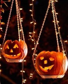 Hang pumpkins from plant hangers and string with lights for nice floating effect.