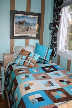 I like the quilt, the pillows, the curtains....I really like the pillows - ribbon! How cool!