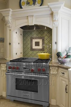 European Kitchen Design - Glass Tile with mixed media elements.  My favorite Kitchen Appliance the Wolf Range