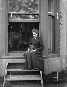 Miss Malcomson on Steps with Dog, A.H. Poole Studio, 1884-1945
