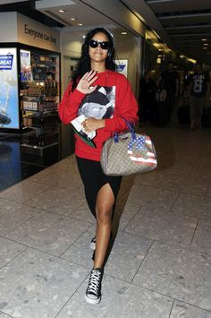 9295b182d7 Rihanna spotted at Heathrow in a maxi skirt with Converse All Star high-tops