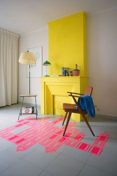 candystorecollective.com >> yellow fire place. floor stencils by Mr. Mr.