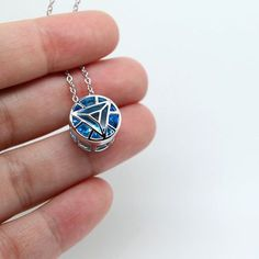 Arc reactor IRON MAN sterling silver necklace This small arc reactor pendant comes directly from the Stark Industries and is made with solid sterling 925 silver, it has a super beautiful blue diamond inside to simulate the energy. It is only 15mm big and comes with a 18 long sterling