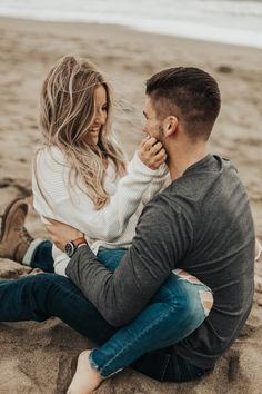Windy Beach Engagement Photos w/ Cuddles at Baker Beach, San Francisco #TONIGPHOTO #bakerbeach #beachengagement #windybeachcuddles Toni G Photo