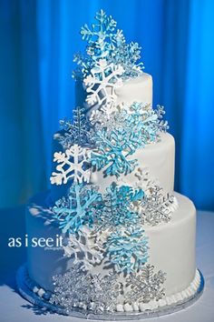 Winter wedding cake! Maybe not as many snowflakes? But love the blue!
