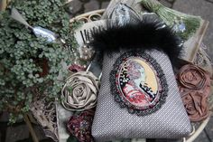 D.O.D.O. Handbag with Portrait Print and Feather Detail