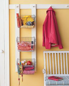 to make this custom organizer. To start, drill a hole in the end of each of two wooden rails to fit the coatrack pegs. Paint rails to match rack; Hang rails from pegs. Attach evenly spaced wire baskets using screw hooks. Martha Stewart Home, Hanging Rail, Hanging Wire, Family Organizer, Wire Baskets, Hanging Baskets, Organization Hacks, Entryway Organization, Entryway Storage