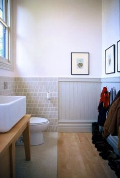 Kid's bathroom-- half wood/half tile--Dwell Hex mix up the entire sink wall, vanity natural wood/antique white top, pale yellow walls. Heath Ceramics Tile, Heath Tile, Eclectic Bathroom, Small Bathroom, Bathroom Ideas, Basement Bathroom, Master Bathroom, Bathrooms, Bad Inspiration