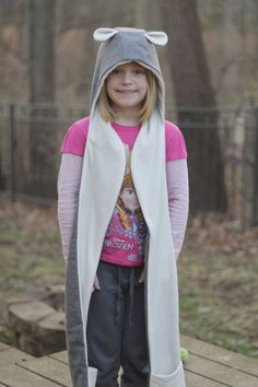 Any kiddo will love this flannel hooded scarf with pockets to keep them warm this winter.