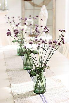 <3 green glass jars, purple flowers, centerpiece <3