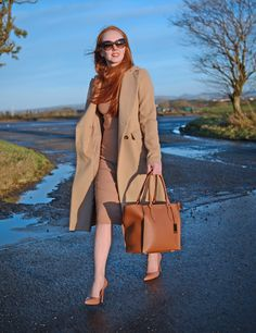 camel coat with camel knit dress and tan shoes