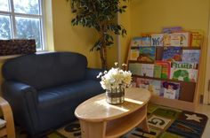 A couch and reading area in the classroom would be an inviting place for parents to sit while waiting for their children. It would also be a great area for them to spend a little time together before or after school.