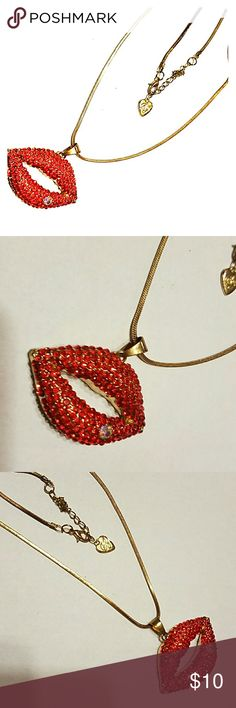 Red crystal lip betsey johnson necklace This super cute besty johnson design is sure to make u smile. The red lip pendent just glisten with crystals. Lips are approx 1inch tall and 2 inch wide (statment worthy). Does come with gold chain,however chain is gold plated and DOES have fading on all the gold. Still very cute. Pre owned, no missing crystals. Betsey Johnson Jewelry Necklaces