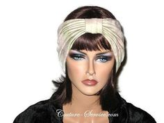"""Sage & Peach Pleated Knot Turban, Handmade by Couture Service This is a BEAUTIFUL fabric! Shown smooth to allow you to see the coloring.This self lined turban has an ultra soft hand, and beautiful neutral coloring! Both the knot, and the turban are hand pleated.Fits a 23"""" to 23 1/2"""" head. The mannequin has a 22"""" head.The stretch will easily accommodate a larger head size."""