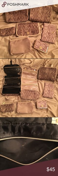 Adrienne Vittadini 7-Piece Cosmetic Travel Set Gently used travel set in the blush snakeskin print. Some items have not been used. The hanging bag on the left has some light makeup staining seen in one of the photos. All magnets and zippers work. Adrienne Vittadini Bags Travel Bags