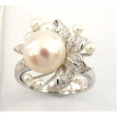 just love the pearl instead of the traditional Diamond engagement ring