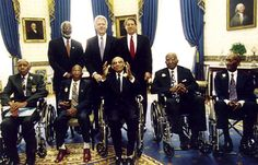 Surgeon General David Satcher, President Bill Clinton, and Vice President Al Gore pose with survivors of the Tuskeegee Syphilis Study following the national apology in 1997.