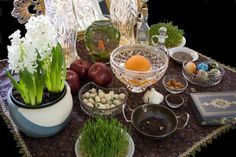 Haft Sinn table for Persian New Year (Nowruz) - foods and things symbolizing wisdom, beauty, prosperity, medicine, new life, fertility, etc going into the new year