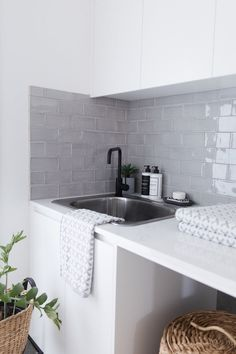 LOVE the tile Moncrieff residence - Studio Black. Hand made subway tiles in a soft grey paired with a Quartz engineered stone benchtop, matte black tap and crisp white joinery. Laundry Room Design, Laundry In Bathroom, Bathroom Grey, Laundry Cupboard, Laundry Storage, Kitchen Decor, Kitchen Design, Laundry Room Inspiration, Decor Interior Design