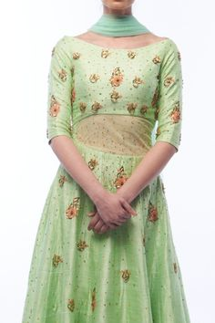 This pistachio-colored raw silk anarkali features a dramatic midriff cut-out and scattered floral embroidery meticulously hand-stitched by artisans in India. #anarkali #madeforyou